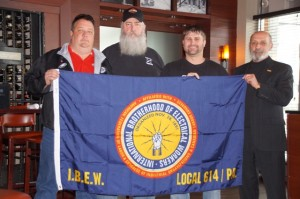 Dan Dawson is presented with an IBEW LU 614 banner to post at his deployment station by his Brothers in the Facilities group including Steward and Executive Board Member Bob McGourn, Vice President / Asst Business Manager Tim Conroy and President / Business Manager Emil Meyer. Dan and his family will be in our thoughts and prayers throughout his deployment.
